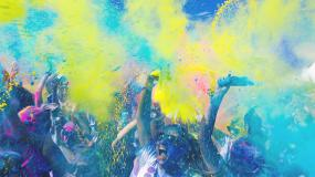 Colorful dust over crowd